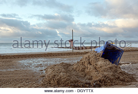 Bournemouth, UK, 28th October 2013. St Jude's Day Storm overturn bins and leave debris at its wake on Boscombe Beach - Stock Photo