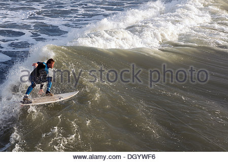Bournemouth, UK, 28th October 2013. St Jude's Day Storm attract surfers to Bournemouth beach, Dorset, UK. The storm, - Stock Photo