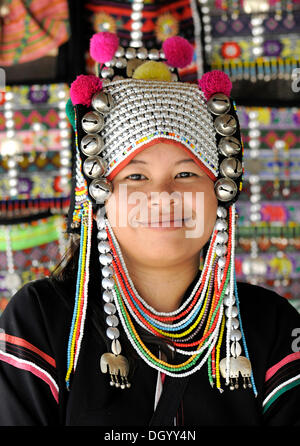 Woman of the Akha hill tribe wearing a traditional headdress, Chiang Rai, Thailand, Asia - Stock Photo