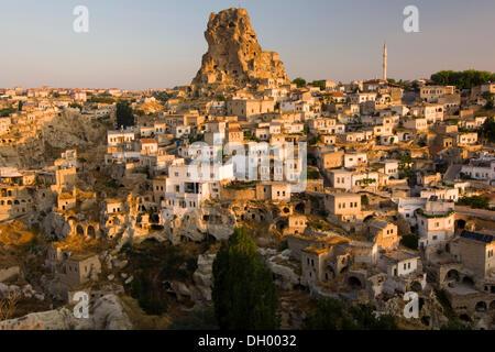 Morning light on Ortahisar, Cappadocia, Anatolia, Turkey, Asia - Stock Photo