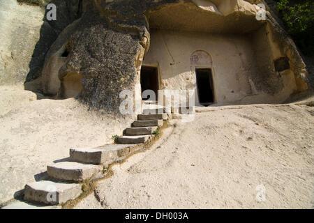 Entrance to a rock church in the open air museum, UNESCO World Heritage Site, Goreme, Cappadocia, central Anatolia, - Stock Photo