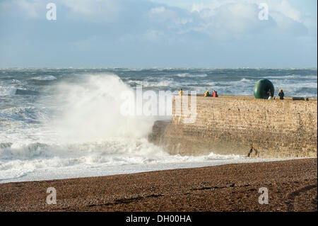 Brighton, UK. 28th Oct 2013. St Jude Storm hits southern UK coastline. Huge waves crashing on Brighton seafront - Stock Photo
