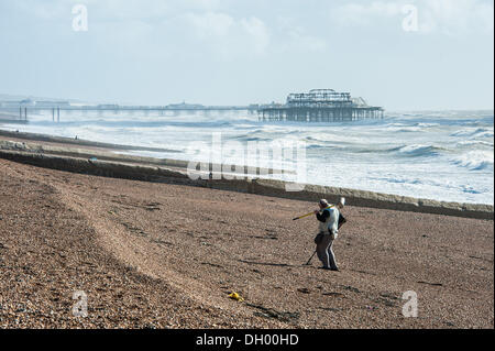 Brighton, UK. 28th Oct 2013. Treasure hunters search the shingle in the aftermath of the storm on Brighton beach. - Stock Photo