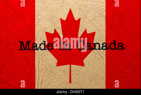 Made in Canada text on flag - Stock Photo