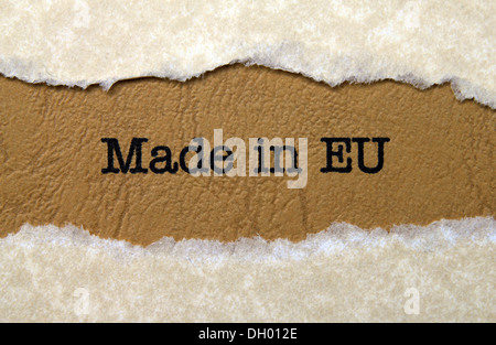 Made in EU text on paper hole - Stock Photo
