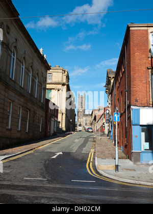 Looking up towards Oldham Parish Curch, St Marys &St Peters from Union street. Oldham, Greater Manchester, UK. - Stock Photo