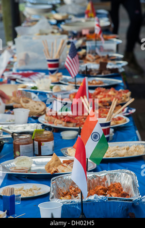 International foods laid out on a long table - Stock Photo