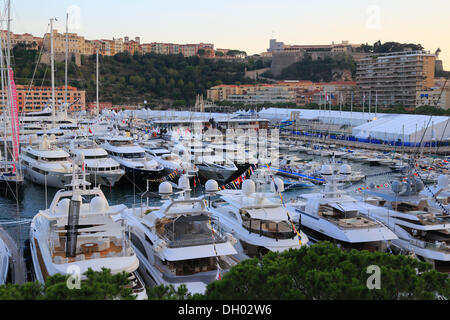 Monaco Yacht Show 2012, Port Hercule in the evening, Prince's Palace at the rear, Principality of Monaco, Cote d'Azur - Stock Photo