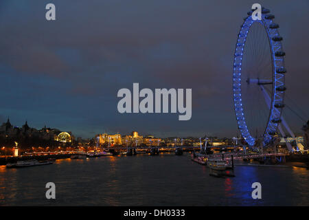 River Thames with the London Eye or Millennium Wheel, seen from Westminster Bridge in the evening, City of Westminster, - Stock Photo