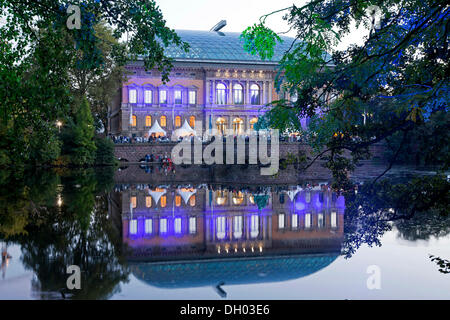Staendehaus building, illuminated for the festival of lights, Kaiserteich pond, Duesseldorf, North Rhine-Westphalia - Stock Photo