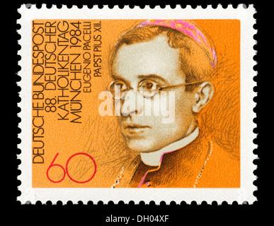 Portrait of Pope Pius XII / Eugenio Maria Giuseppe Giovanni Pacelli (1876-1958) on German postage stamp. - Stock Photo
