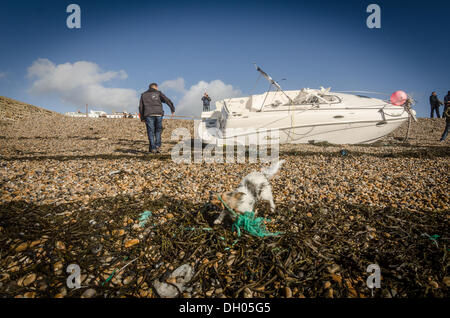 Brighton, UK. 28th Oct, 2013. The placebo,a small pleasure boat is washed ashore next to Brighton Marina after gale - Stock Photo