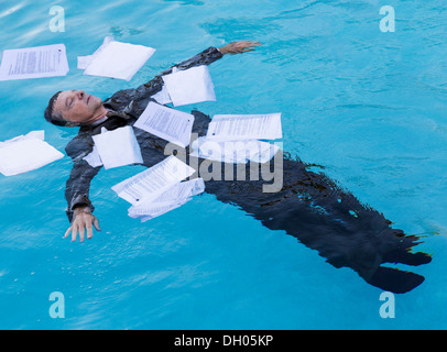 Businessman in debt - Stock Photo