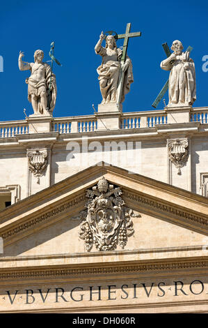 Monumental statues of John the Baptist, Jesus Christ and an apostle on the facade of St. Peter's Basilica, Piazza - Stock Photo
