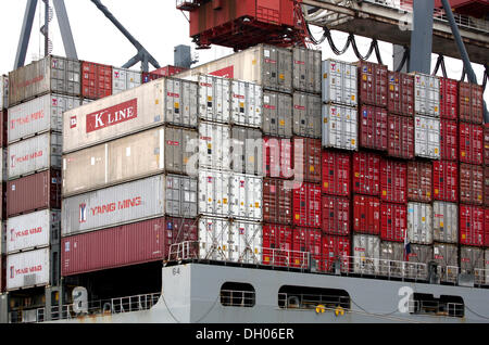 Containers being loaded on a ship in the port of Hamburg - Stock Photo