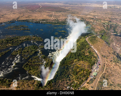 Victoria Falls on the Zambezi River, aerial view with rainbow - Stock Photo