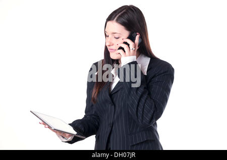 Businesswoman using a tablet PC - Stock Photo