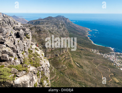 Climbers on face of Table Mountain above Cape Town in South Africa - Stock Photo