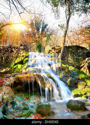 Autumn waterfall in the mountains of Crimea - Stock Photo
