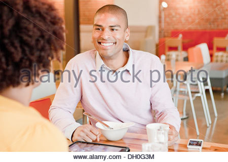 African American business people working in cafe - Stock Photo