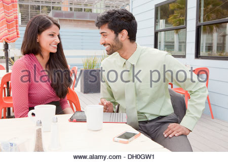 Indian business people talking in cafe - Stock Photo