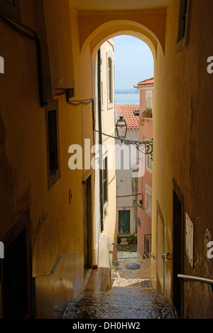 Narrow street, Alfama district, Lisbon, Portugal, Europe - Stock Photo