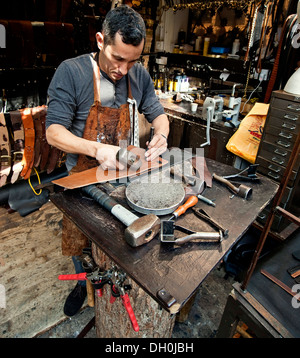 leather worker,Man crafting leather, hand made, leather goods. - Stock Photo