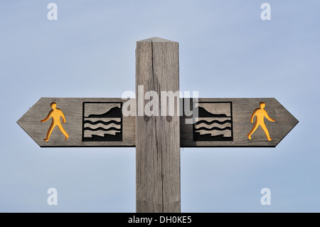 Wooden finger signpost showing the route of the Wales Coast Path near Aberystwyth, Ceredigion, Wales, UK - Stock Photo