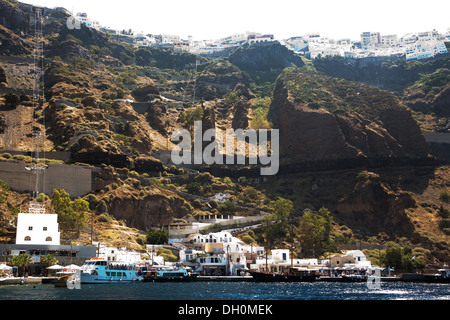 Skala Pier, the Old Port of Santorini, seen from the water sailing south in Santorini, Greece on July 5, 2013. - Stock Photo