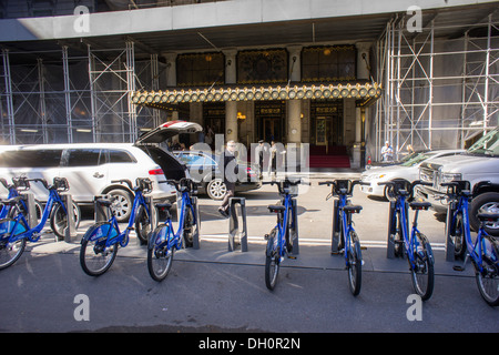A CitiBike docking station in Grand Army Plaza, in front of the Plaza Hotel, in New York - Stock Photo