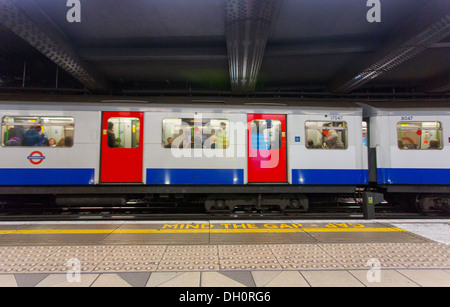 26/10/2013 Mind The Gap. warning sign and London tube train in a station, London, England, UK - Stock Photo