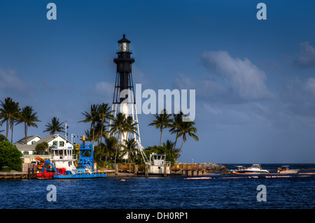 The Hillsboro Inlet Lighthouse viewed from the Pompano Beach Hillsboro Inlet Park on Highway A1A. - Stock Photo