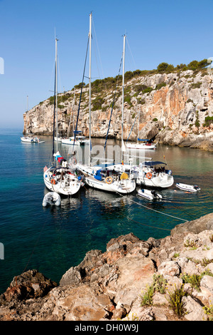 Yachts moored in the bay of Cales Coves, South Menorca, Menorca Island, Balearic Islands, Spain, Southern Europe - Stock Photo