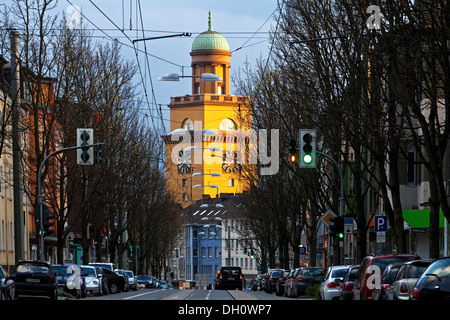 Town Hall Tower in the evening light with Hauptstrasse, the main road of Witten, Ennepe-Ruhr district, North Rhine - Stock Photo