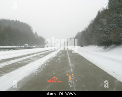 Driving on the motorway with a BMW 5 Series in bad weather conditions, Head Up Display, distance radar and traffic - Stock Photo