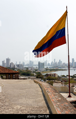 View from the castle to the city of Cartagena de Indias, Colombia with a Colombian flag in the foreground. - Stock Photo