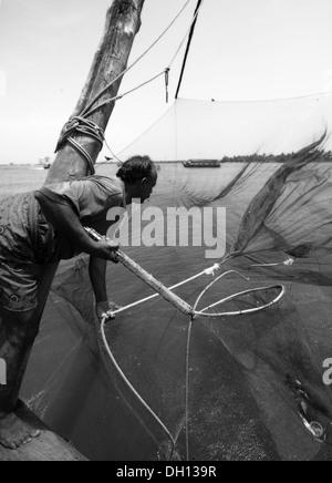 Traditional Chinese Fishing Nets at Fort Kochi - Stock Photo