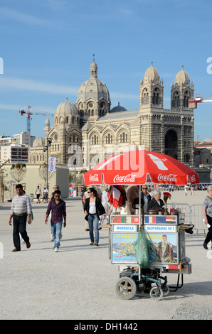 Mobile Drinks Seller Hawker or Itinerant Vendor in Front of Marseille Cathedral or Cathedrale de la Majeure Marseille - Stock Photo