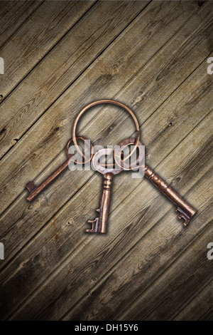 old keys over a wood - Stock Photo