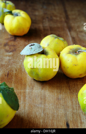fresh quince on an old table, food - Stock Photo