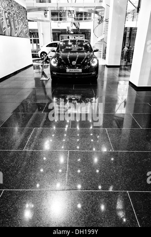 Car dealer selling Volkswagen. Black and white. - Stock Photo