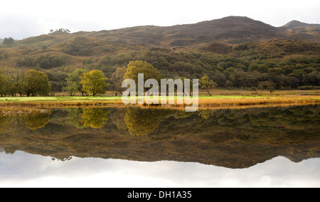 Early Morning Reflections on Llyn Dinas, Autumn, Snowdonia National Park - Stock Photo