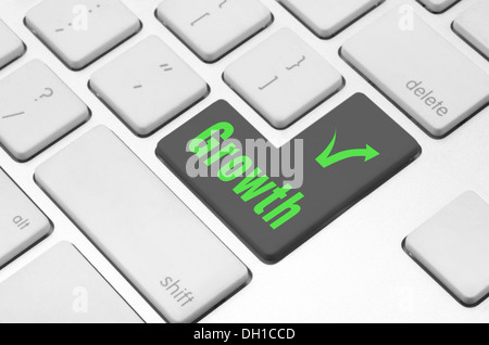 Growth key on the computer keyboard - Stock Photo