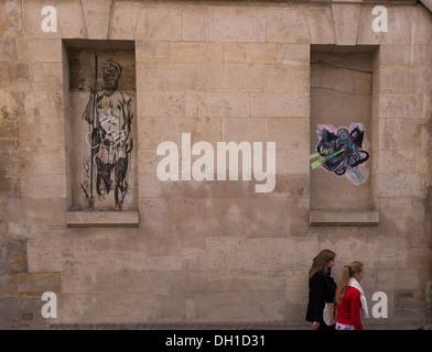 Drawing graffiti in Paris, France - Stock Photo