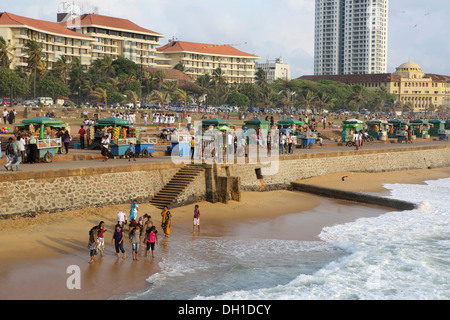People enjoying a sunny afternoon on Galle Face beach in Colombo, Sri Lanka - Stock Photo