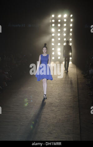 Beijing, China. 29-OCT-2013; A model showcases designs on the catwalk at HUAFU Gioia Pan Collection show during - Stock Photo