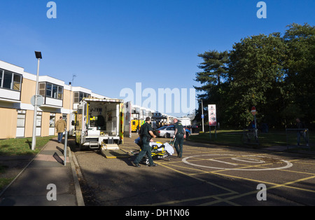 Ambulance crew transfer a patient from the back of an ambulance into the Queen Elizabeth Hospital, King's Lynn, - Stock Photo