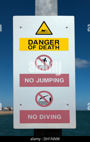 Danger of Death Sign: No Diving, No Jumping, on Deal Pier, Kent. - Stock Photo