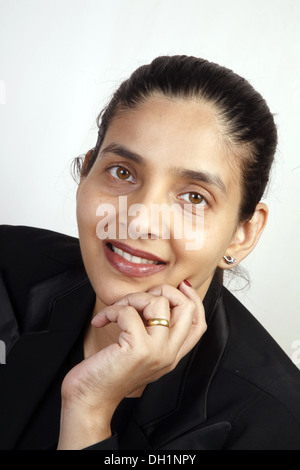 young woman black coat ring eye contact looking at camera MR#743AF - Stock Photo