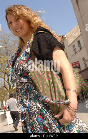 Reusable shopping bags are a kind of carrier bag, which are available for sale in supermarkets and apparel shops. - Stock Photo